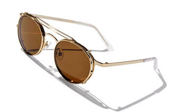 Fashion sunglasses with gold frames and brown tinted lenses